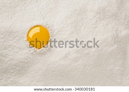egg yolk on flour - stock photo