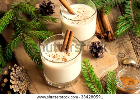 Eggnog with cinnamon for Christmas and winter holidays - stock photo