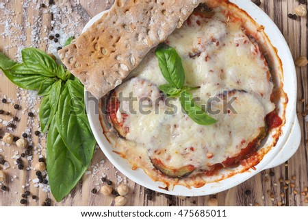 eggplant baked with tomatoes and cheese and bread. healthy food.