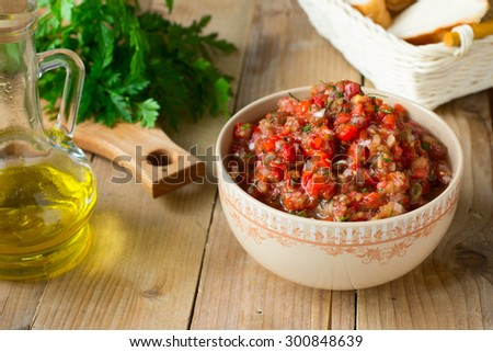 Eggplant caviar with tomatoes and roasted bell pepper - stock photo