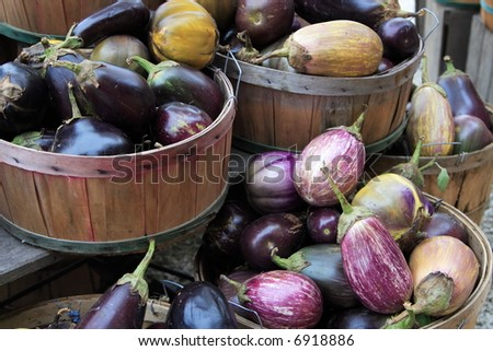 Eggplant in baskets at a road side farm stand - stock photo