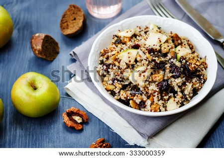 Eggplant quinoa apples dried cranberry salad. toning. selective focus