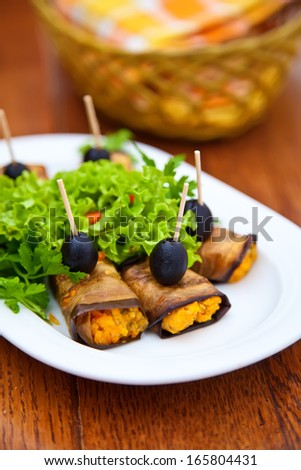 eggplant rolls stuffed with cheese, carrot and garlic