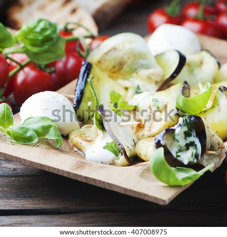 Eggplant rolls with cottage cheese, selective focus and square image - stock photo