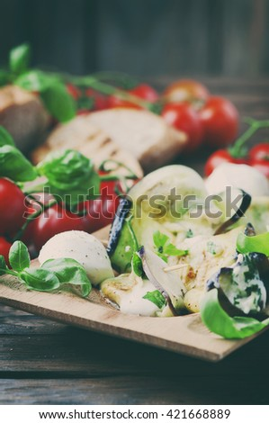 Eggplant rolls with mozzarella cheese, selective focus and toned image - stock photo