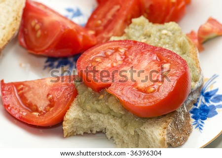 Eggplant salad with tomato and shallow depth of field - stock photo