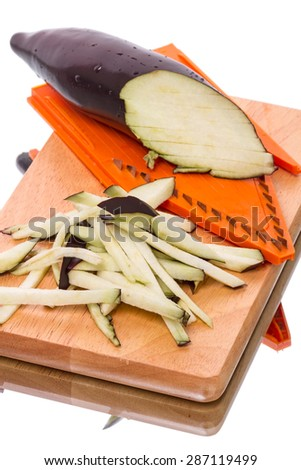 Eggplant shredded and grater on kitchen board - stock photo