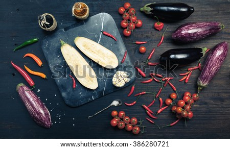 Eggplants / cooking background, healthy food and diet concept. Rustic style. Top view - stock photo