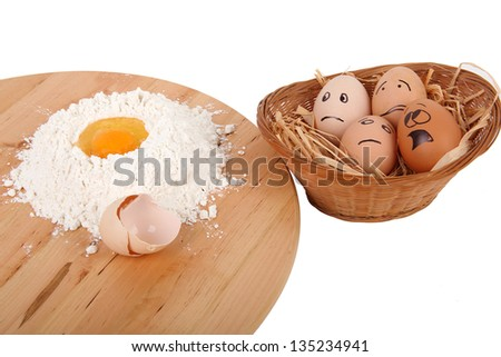 Eggs afraid in the basket near the preparations for the cake - stock photo