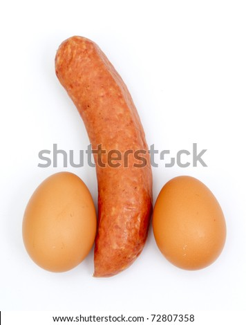 Eggs and sausage ordered like penis and testicles isolated on white - stock photo