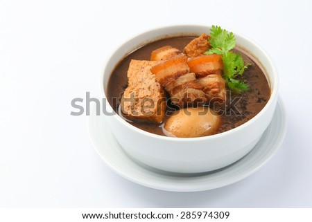 Eggs and sweet pork with fried tofu,boiled in brown sauce(Thai food called Pa lo ) - stock photo