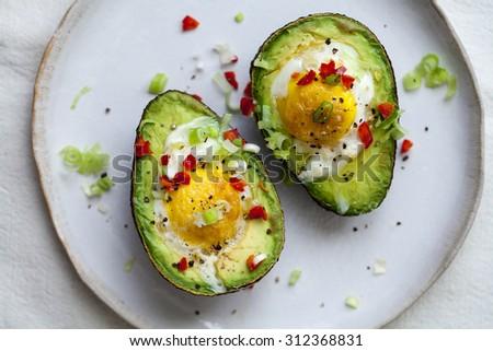 Eggs baked in avocado - stock photo