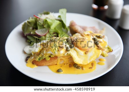 Eggs Benedict toasted English muffins,bacon, poached eggs - stock photo