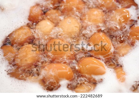 Eggs boiled with water in the pot - stock photo