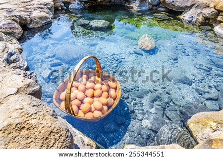 Eggs boiling in hot spring, Chae Son Hot Spring at Lampang province, Thailand - stock photo