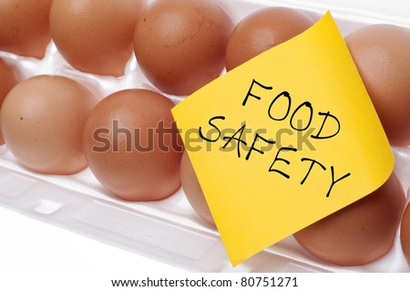 Eggs Can Carry Salmonella Food Safety Concept Concept with Brown Egg and Yellow Note. - stock photo