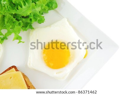 eggs,cheese, salad, and bread on white plate