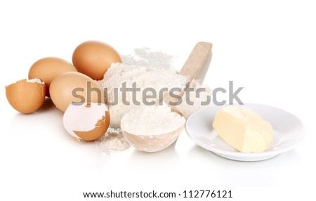 Eggs, flour and butter isolated on white - stock photo