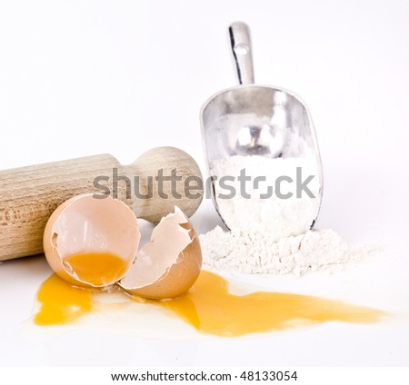 Eggs flour and rolling pin - stock photo