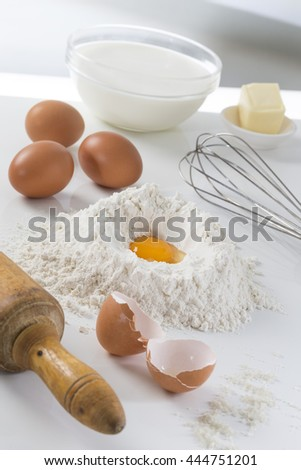 eggs, flour, milk, butter and kitchen utensils - stock photo