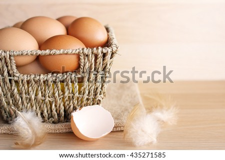 Eggs in a basket on a wooden table.