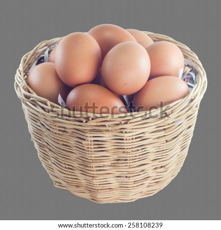 Eggs in a basket on gray background - stock photo