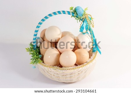 Eggs in a basket white background. - stock photo