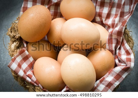 eggs in a basket wooden background