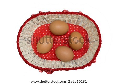 Eggs in a fashion basket isolated on white background (Easter concept) - stock photo