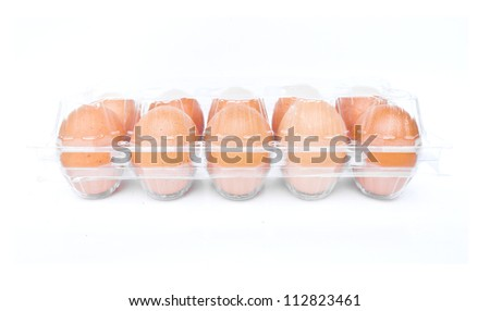 eggs in a plastic carton isolated on a white background - stock photo