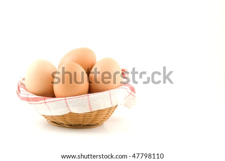 eggs in a wicker basket on white background