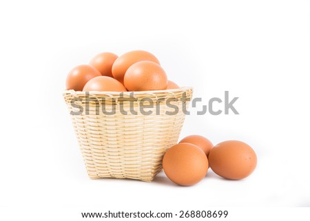 Eggs in basket on white background. - stock photo