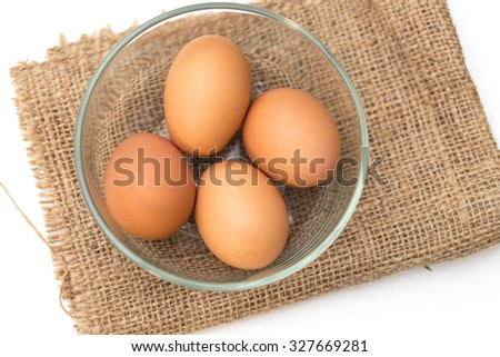 eggs  in bowl on sack  background