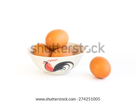 Eggs in bowl on white background - stock photo