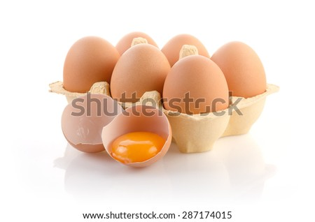Eggs in carton on white with clipping path - stock photo