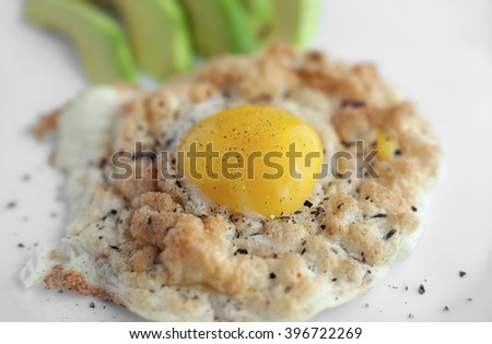 Eggs in Clouds, a oven dish and cook the egg white and egg yolk separately. - stock photo