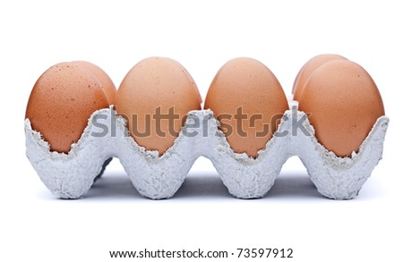 Eggs in container isolated on white - stock photo