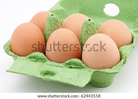 Eggs in green carton - stock photo