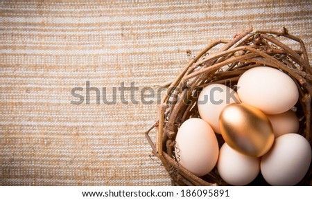 Eggs in nest on linen fabric close-up - stock photo