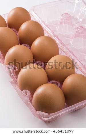 Eggs in plastic container - stock photo