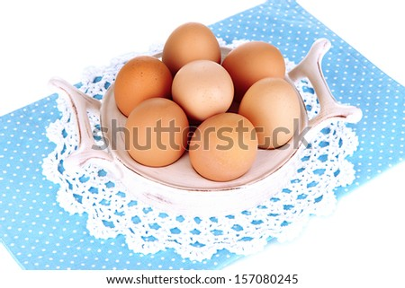 Eggs in plate for eggs isolated on white