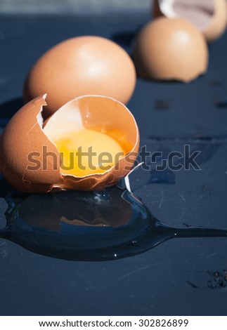 Eggs in shells - macro shot with shallow depth of field. Still life photo. Dough ingredient. - stock photo