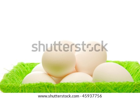 Eggs in the green Easter basket.
