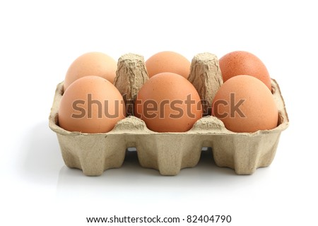 eggs in the package isolated in white background - stock photo