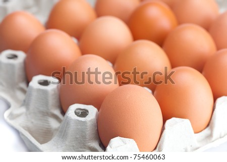 eggs in the package  isolated on a white - stock photo