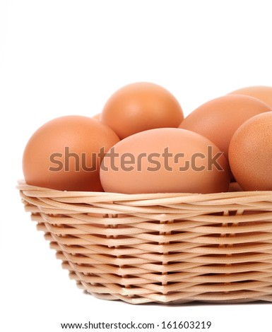 Eggs in the wicker basket. Isolated on a white background