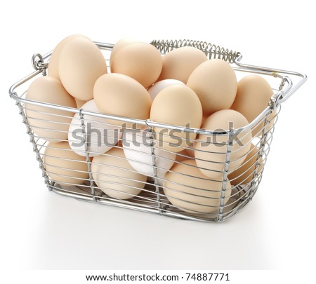 eggs in wire basket on white background - stock photo