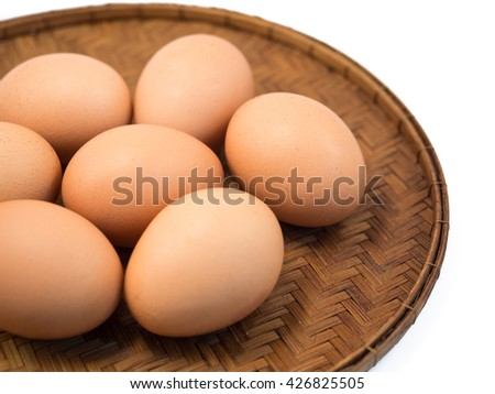 Eggs Lay On The Wooden Flat Basket (Closeup) - stock photo