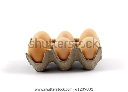 Eggs on a tray against white background - stock photo