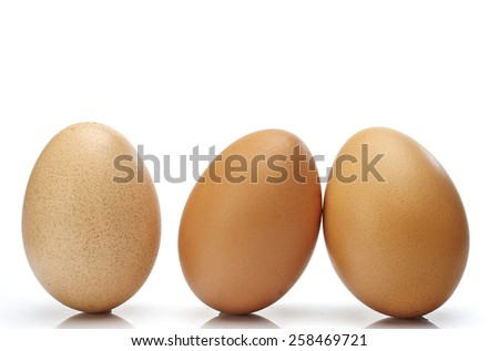 Eggs on it on a white background. - stock photo